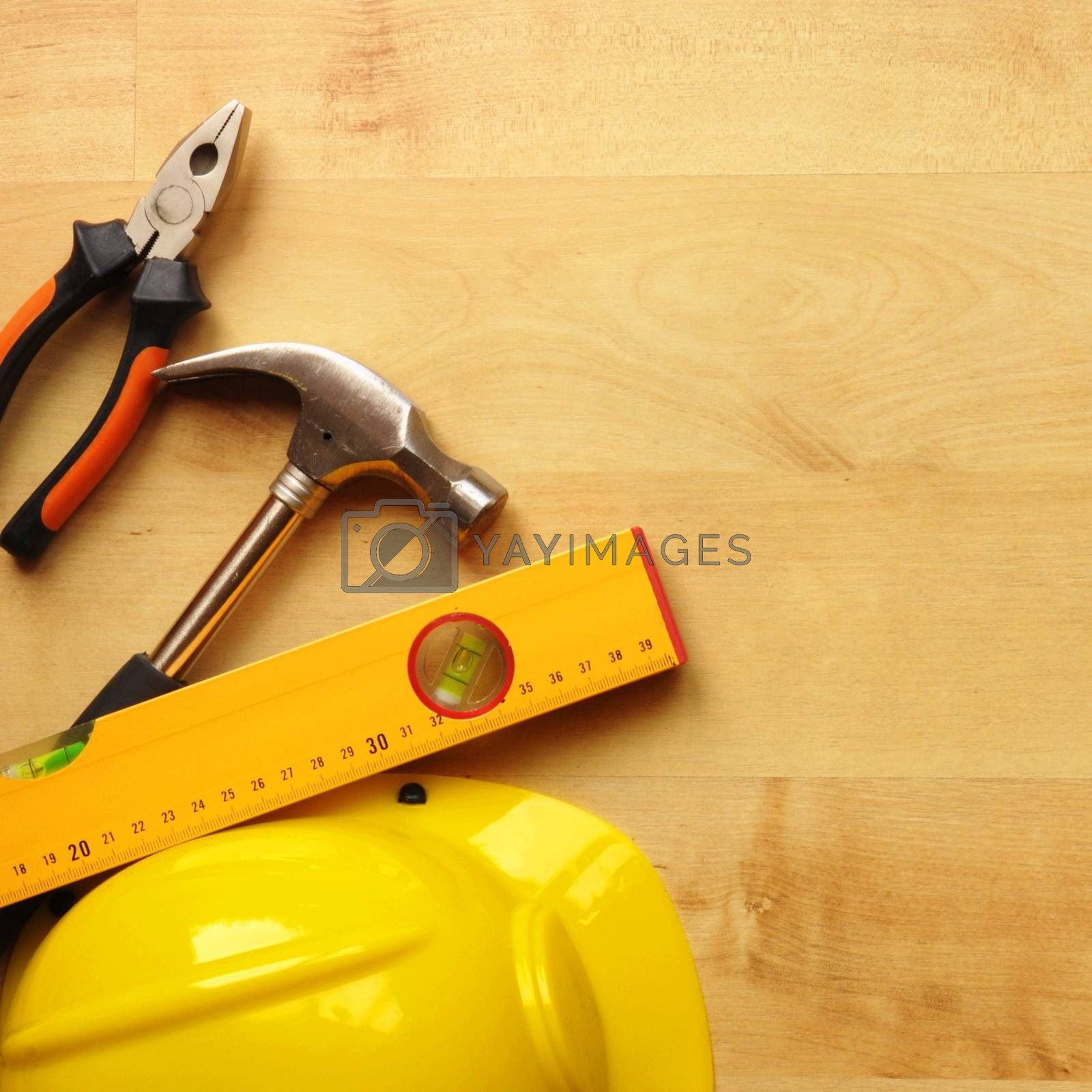Royalty free image of hard hat and tool by gunnar3000
