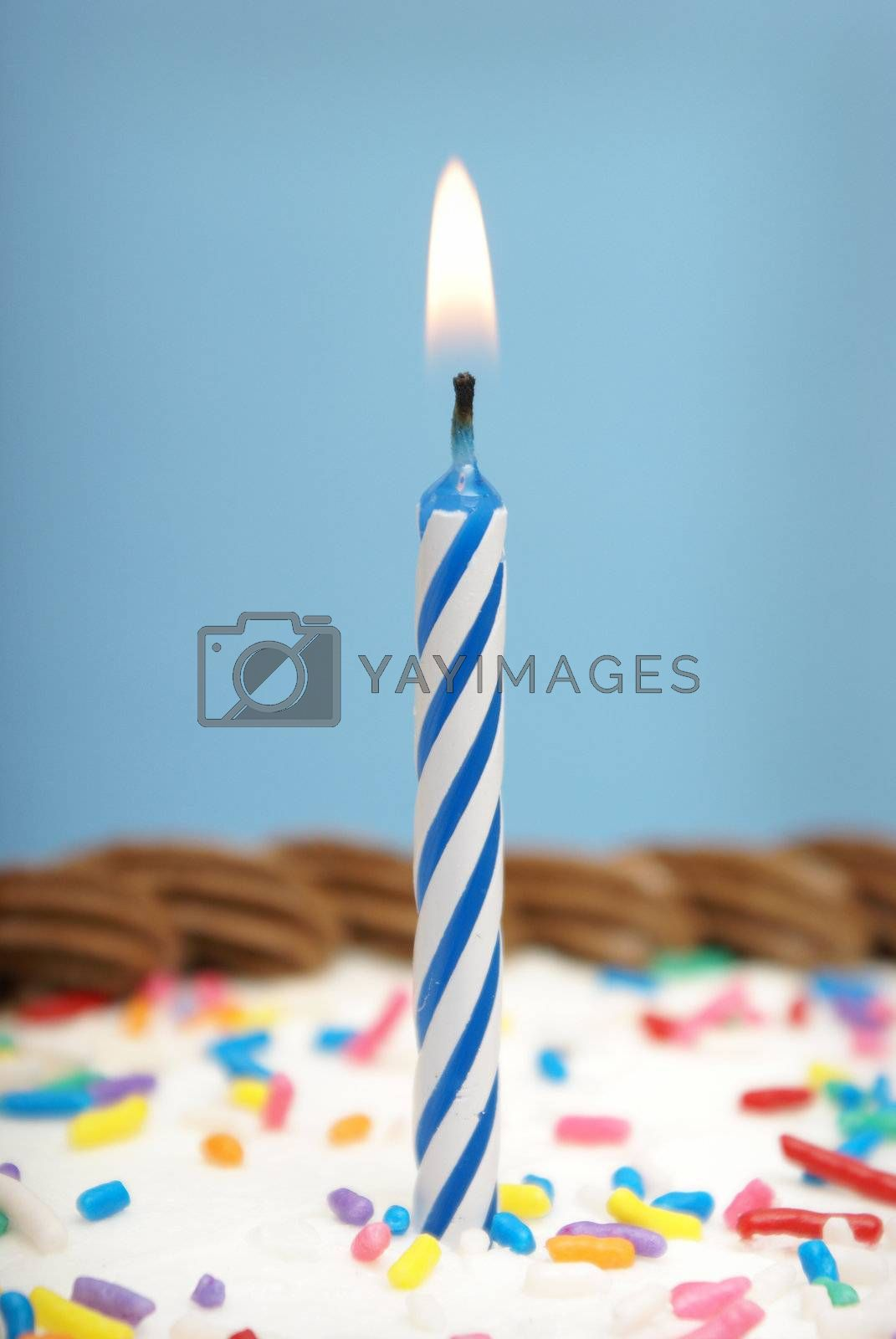 A celebration using a candle and some cake.