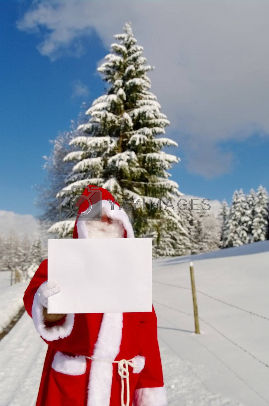 Santa Claus, Father Christmas holding blank sign