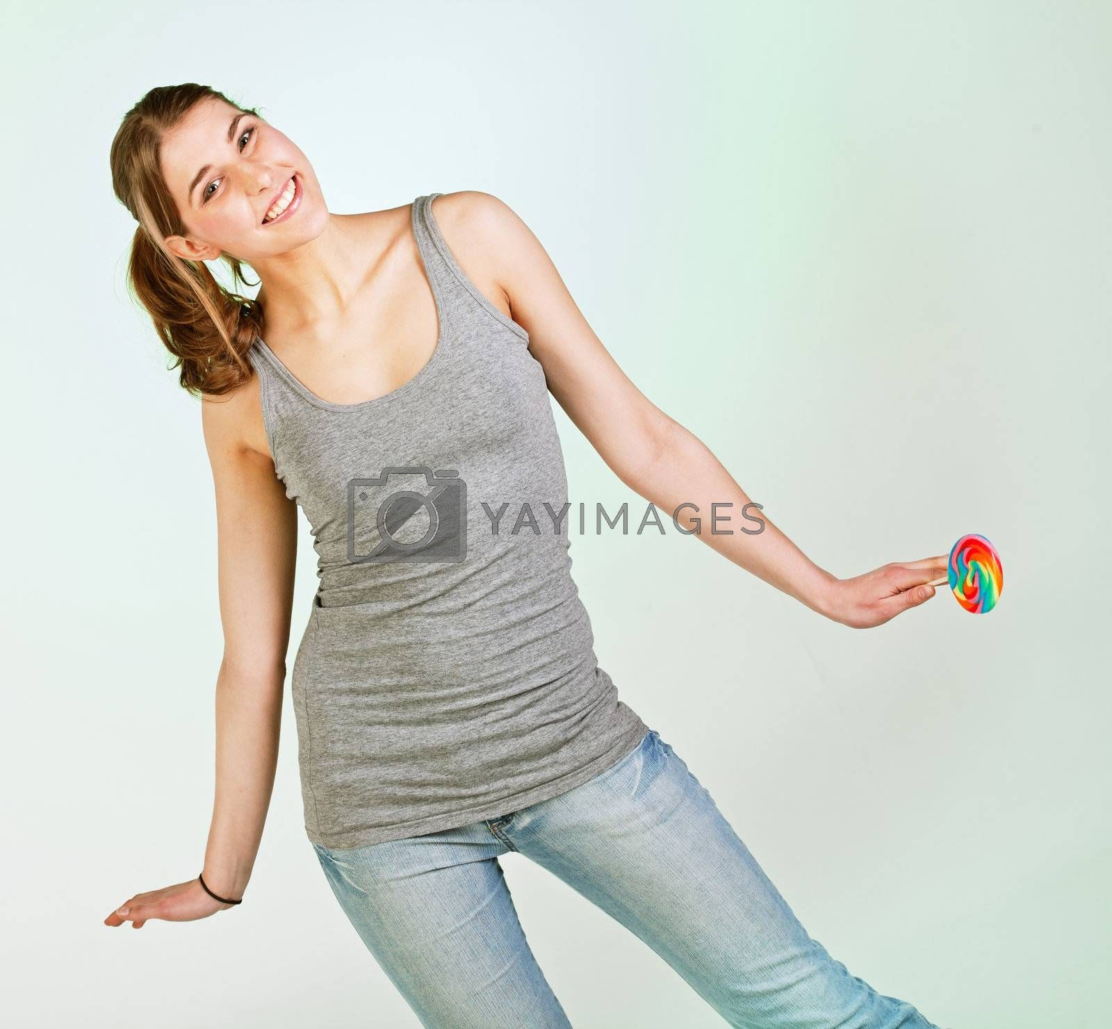 Portrait of playful pretty teenager girl against white background