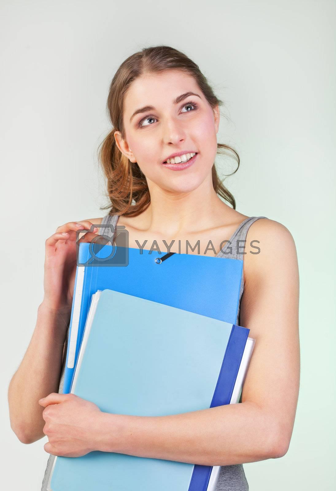 Pretty teenager girl holding blue plastic folders