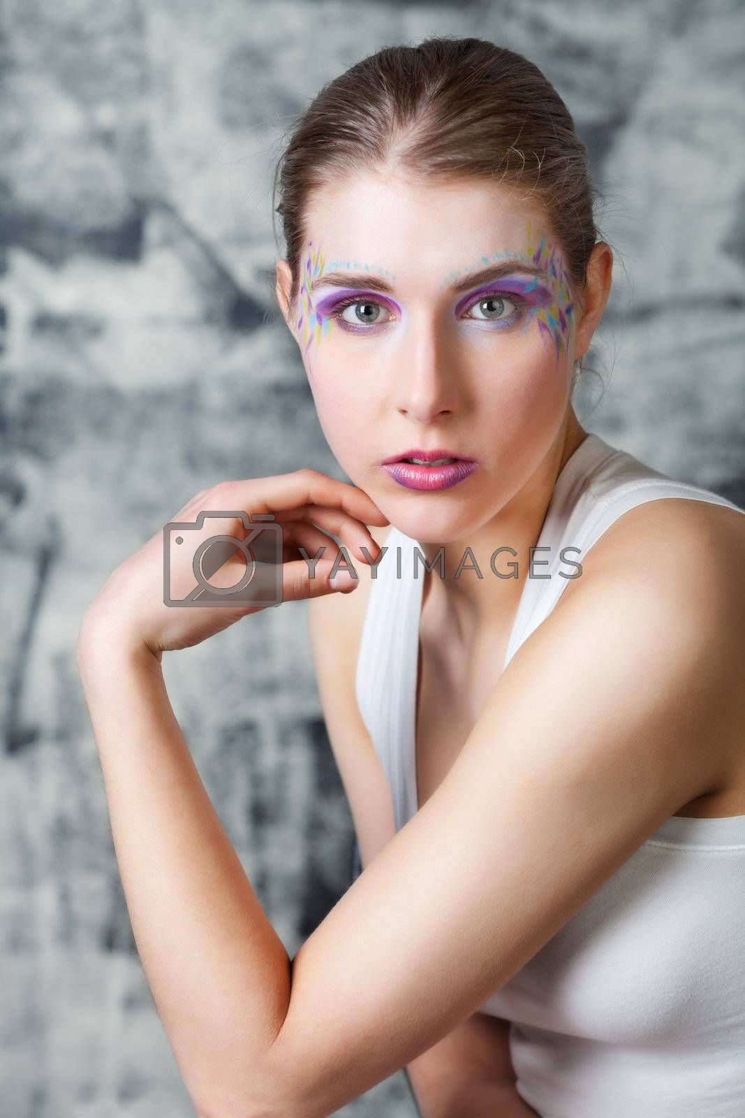 portrait of a pretty young woman with face art