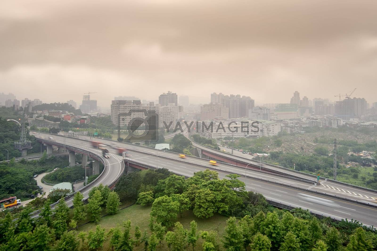 Sunset cityscape of highway and buildings with bad weather and air pollution, city scenery in Taipei, Taiwan.