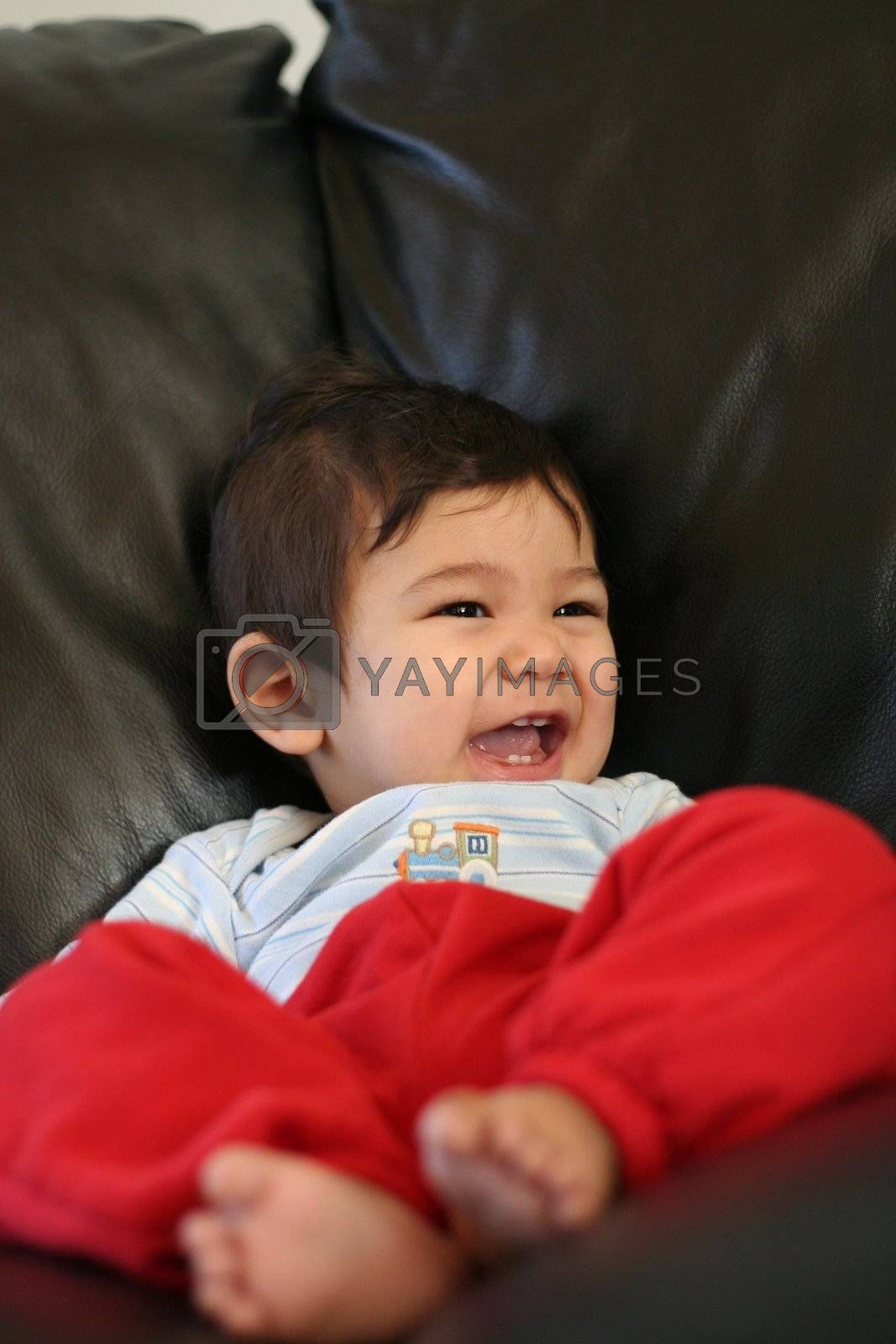 Baby boy relaxing on couch