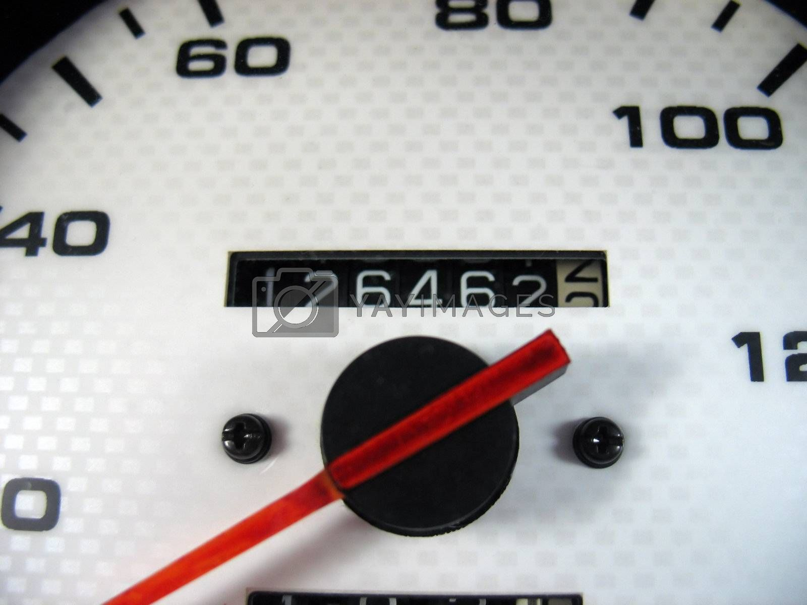A macro shot of a speedometer & odometer from a car.