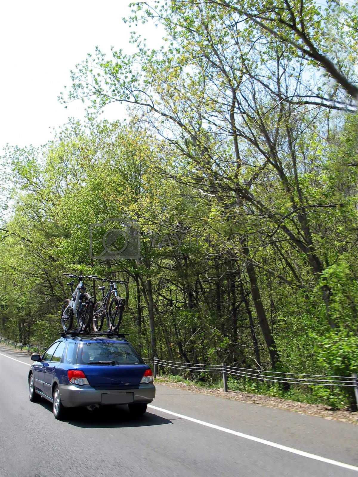 a car carrying a couple of mountain bikes on its way to it's destination