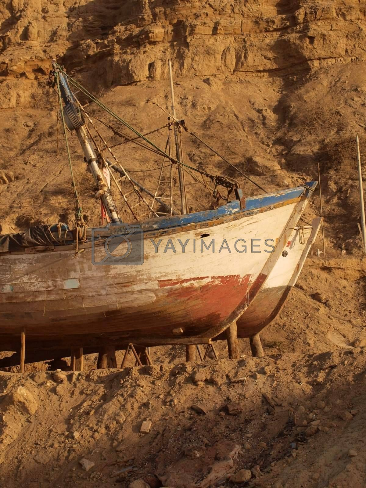 Ships parked on the sandy shore for reparation