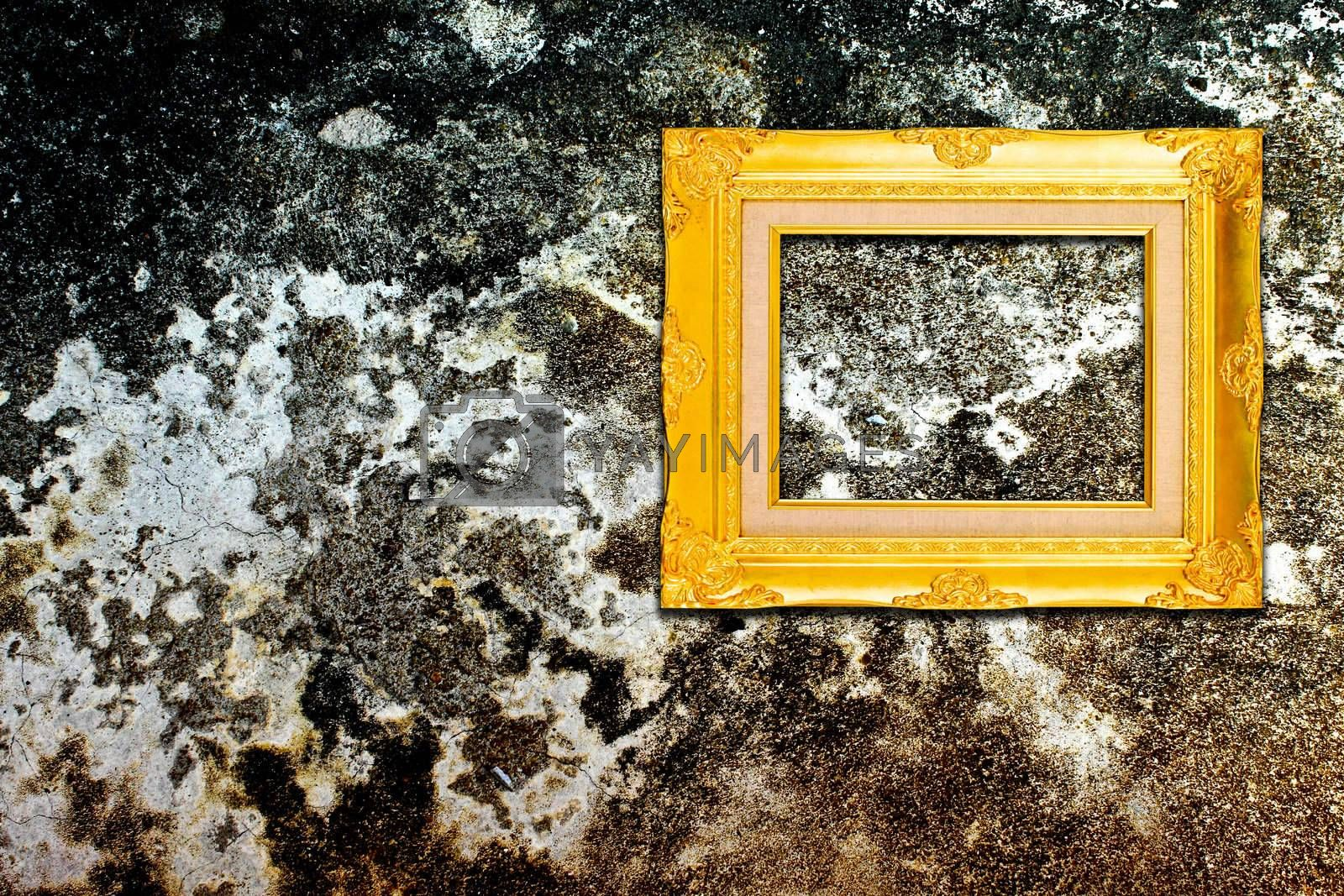 Rough old wall with vintage gold frame