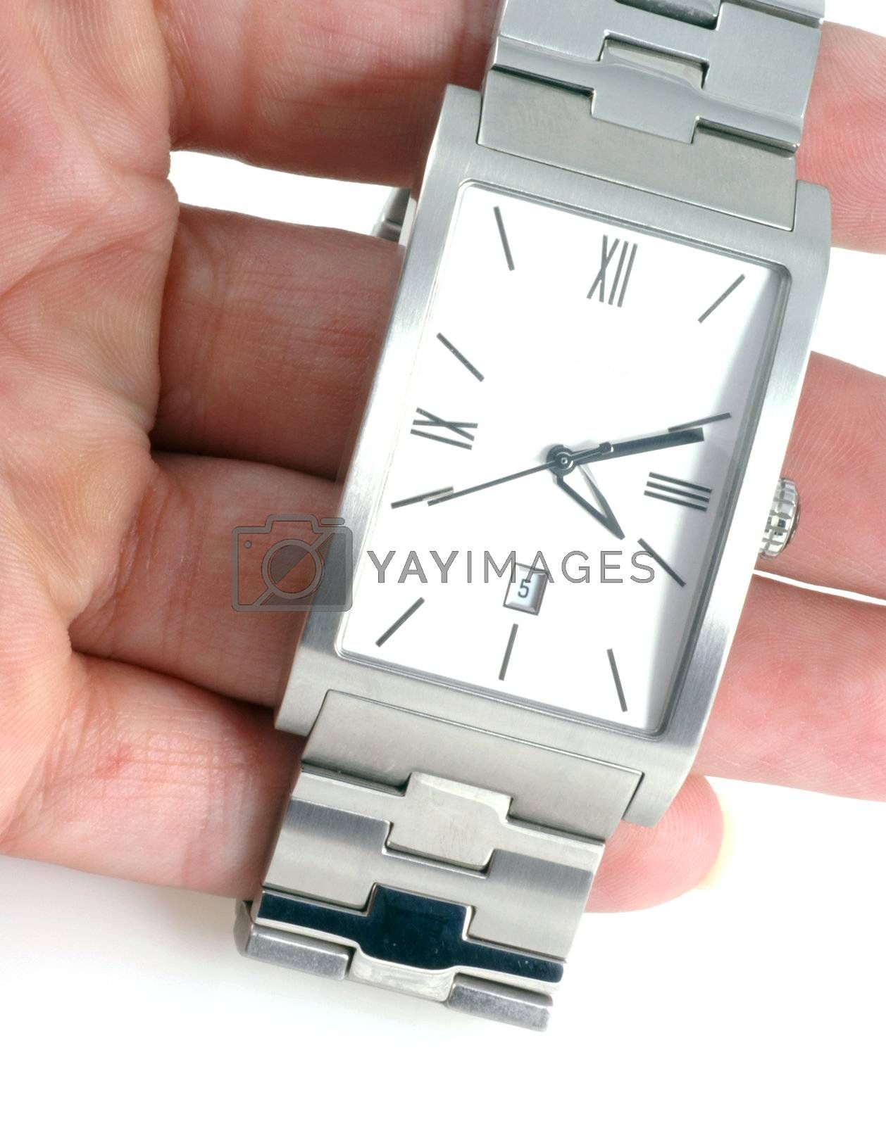 Hand holding up a watch isolated on a white background.