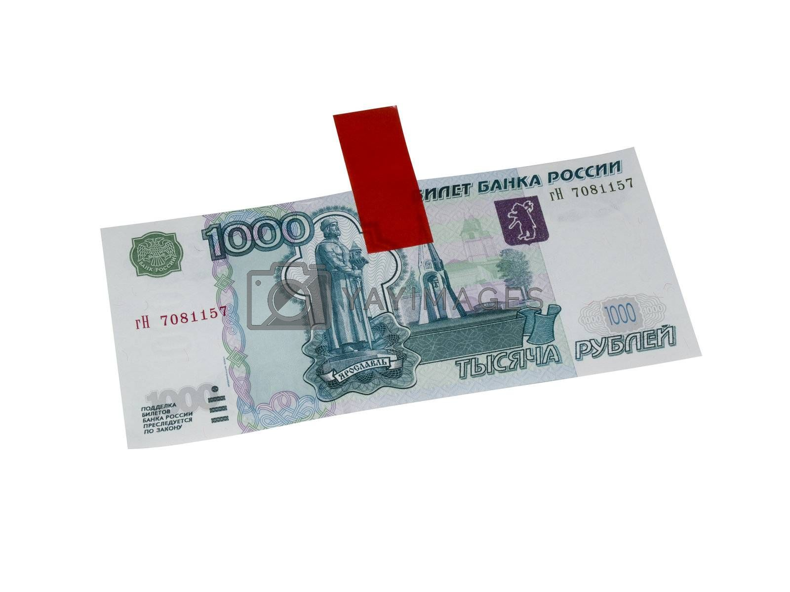 Russian money. 1000 roubles and adhesive tape isolated on white