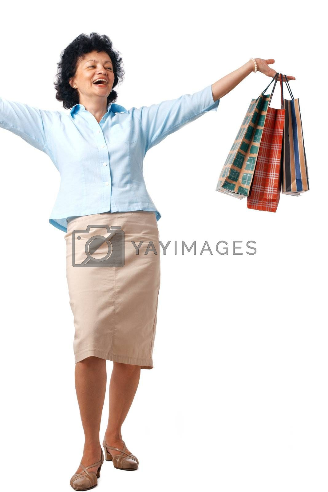 Senior Woman with shopping bags over white background.