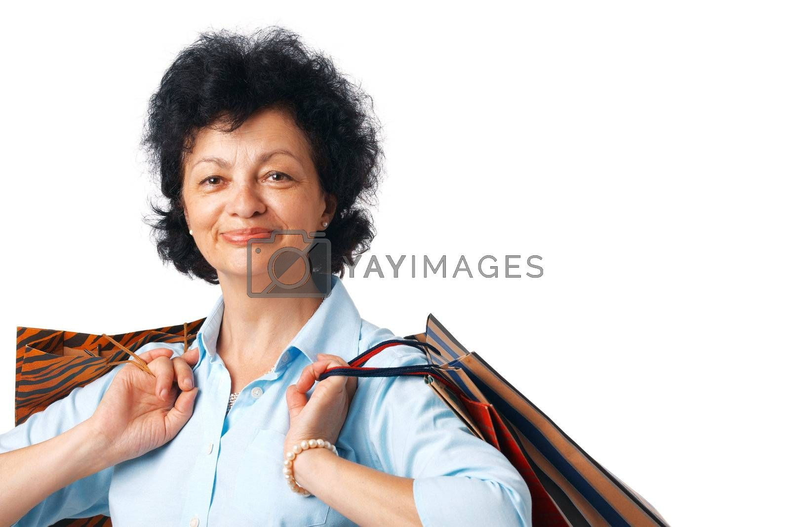 Close up portrait of elder woman with shopping bags.
