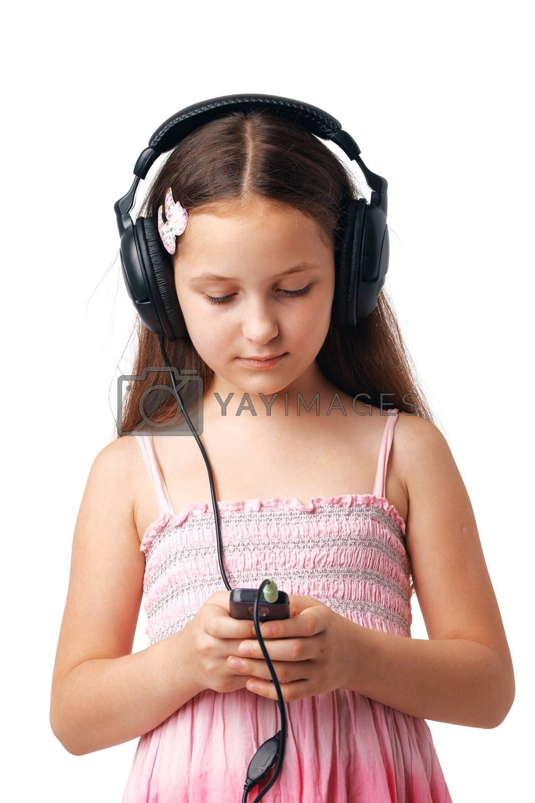 Young girl with headphones looking at something in her mobile or player.
