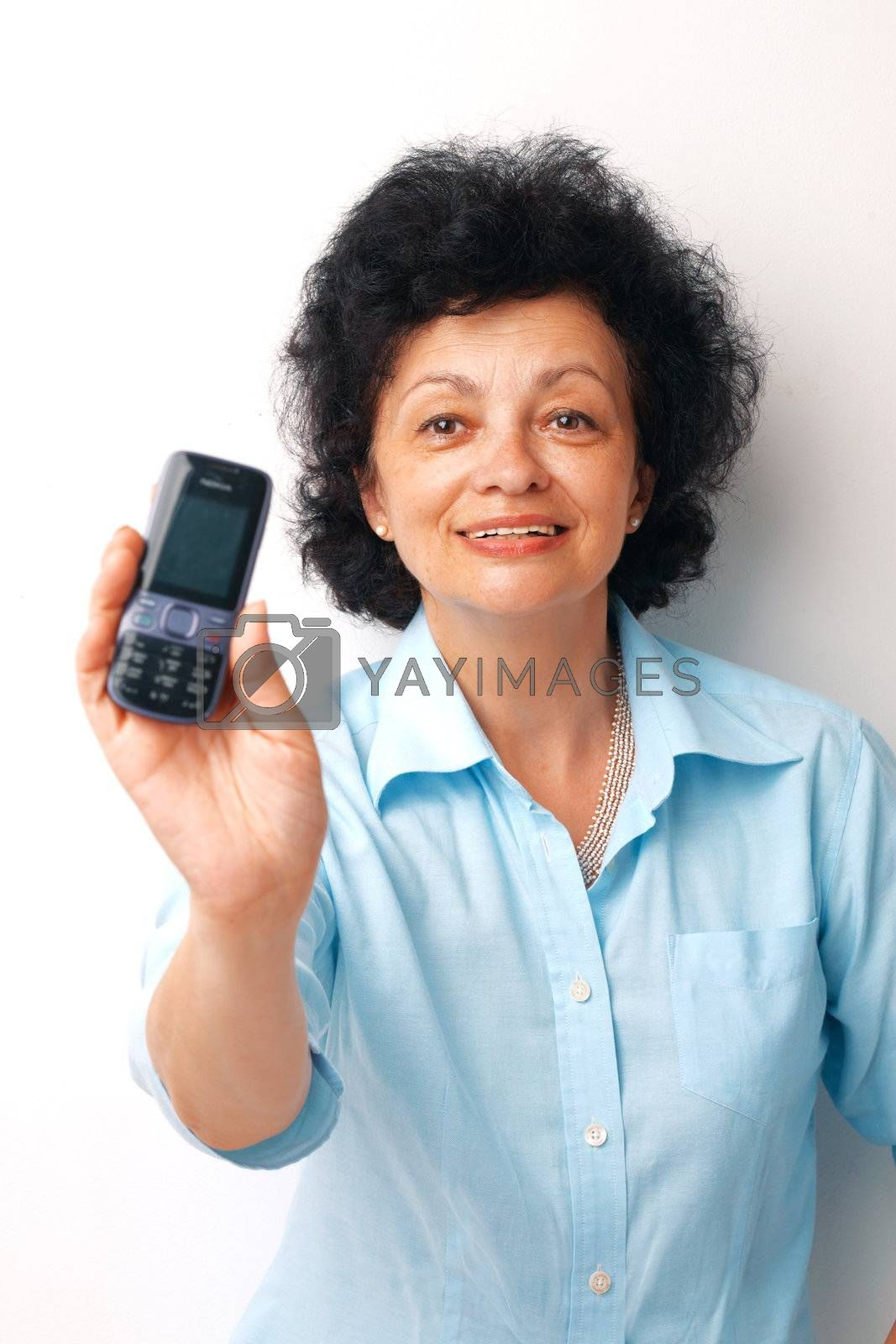 Elder smiling woman holding and showing her mobile.
