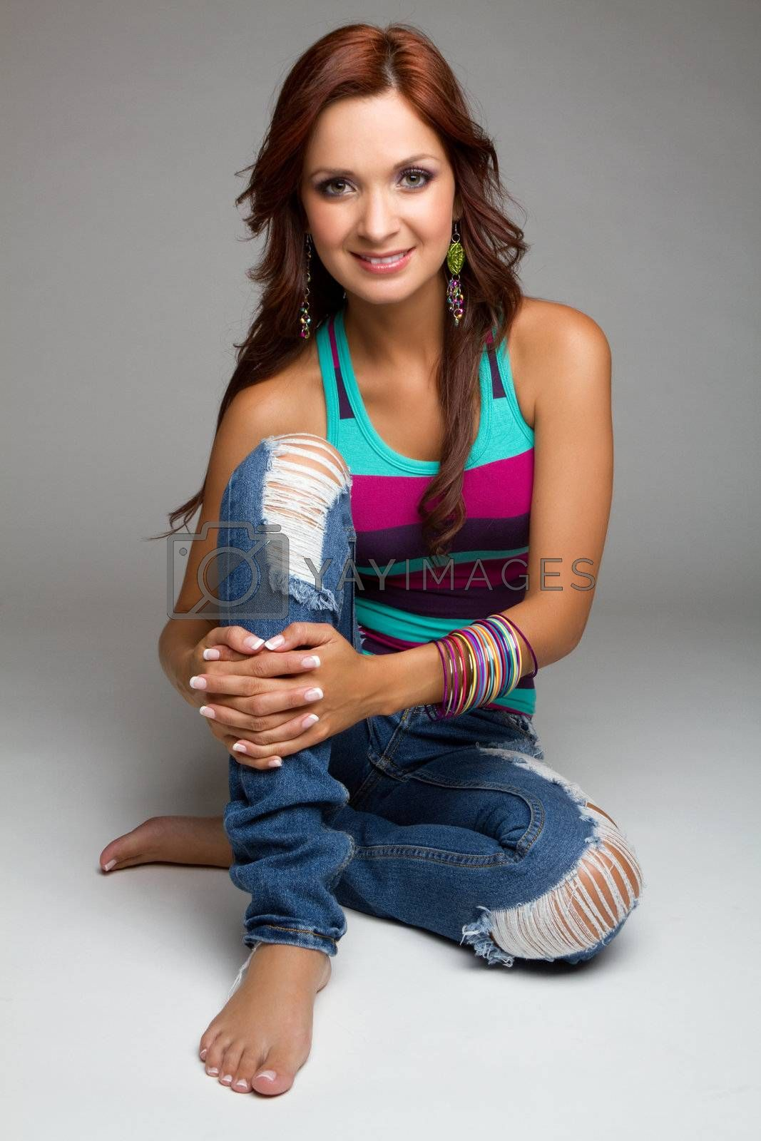 Beautiful sitting young woman smiling