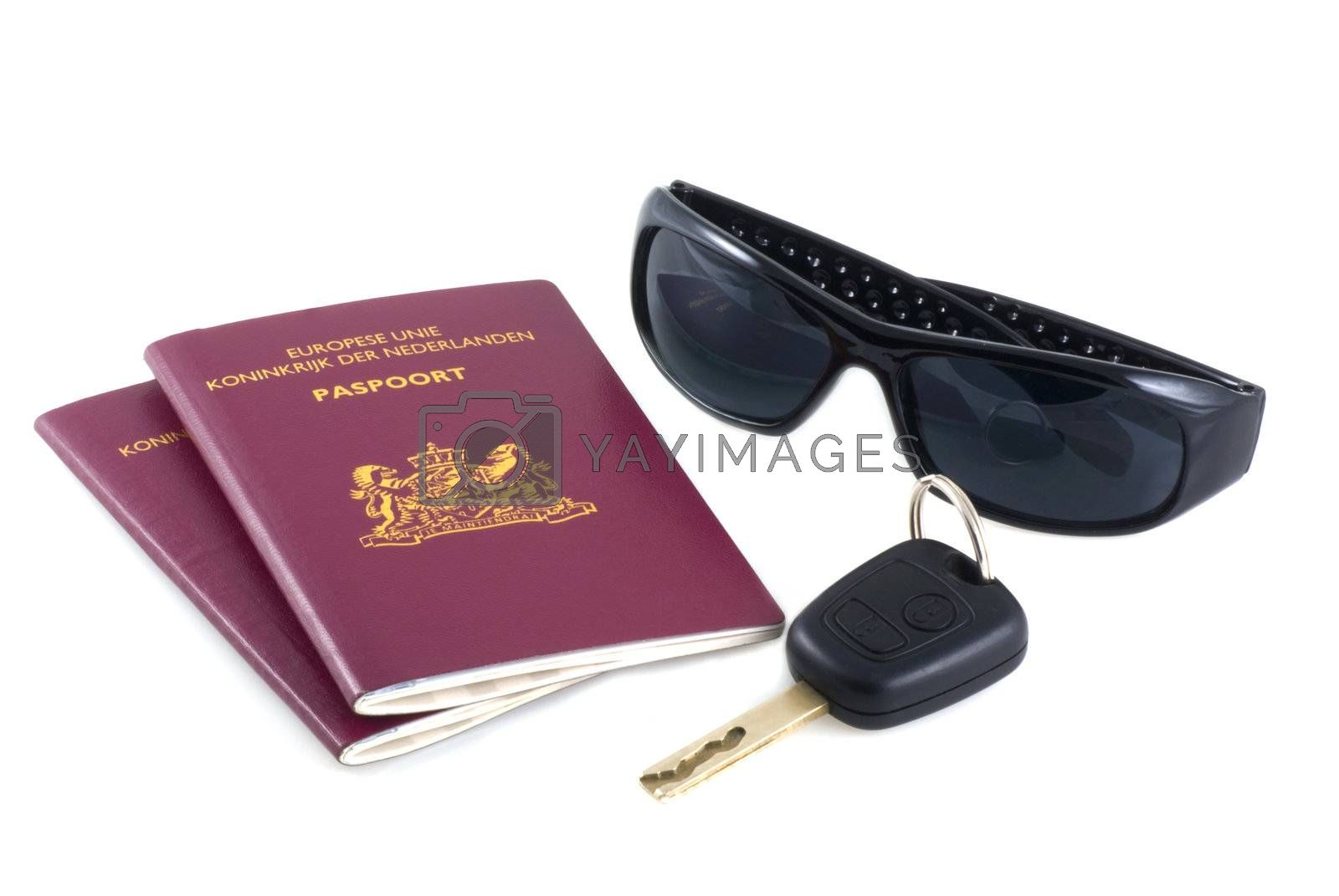 Passports, shades and a car-key on a white background.