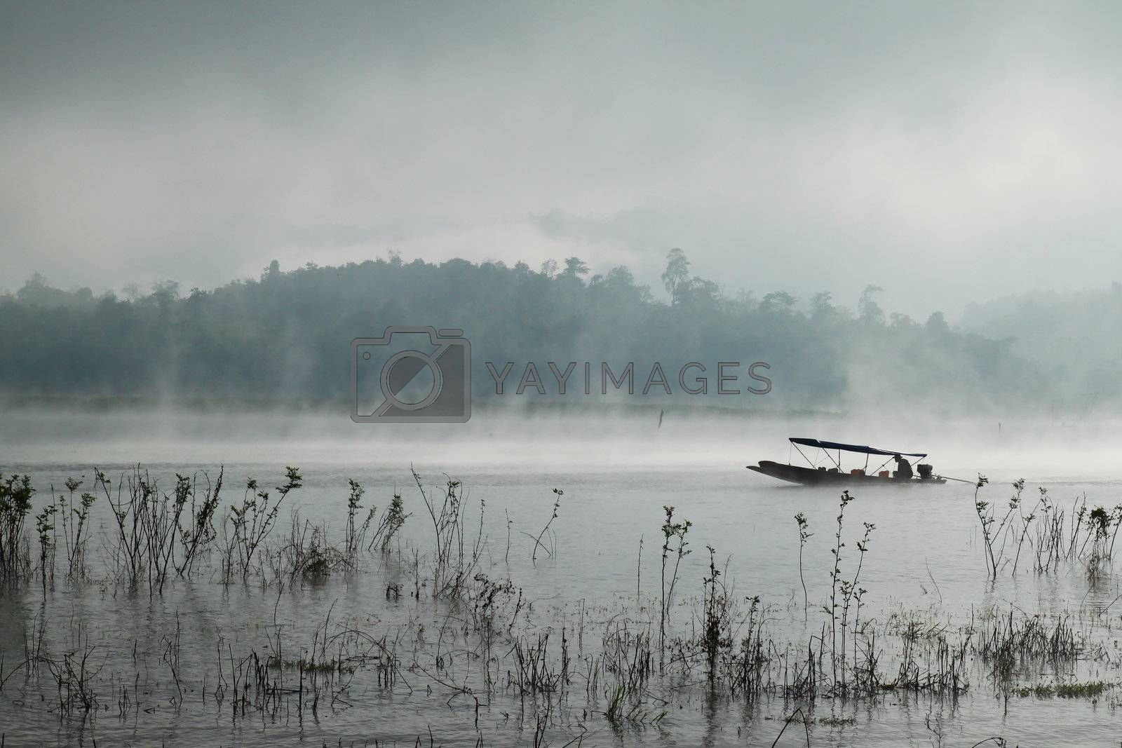 A man rowing his boat in river at Sangkhlaburi, thailand