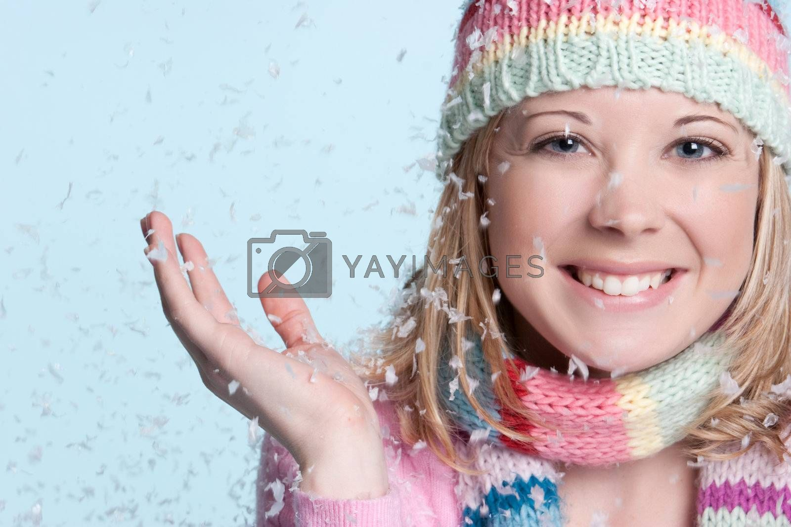 Smiling woman in falling snow