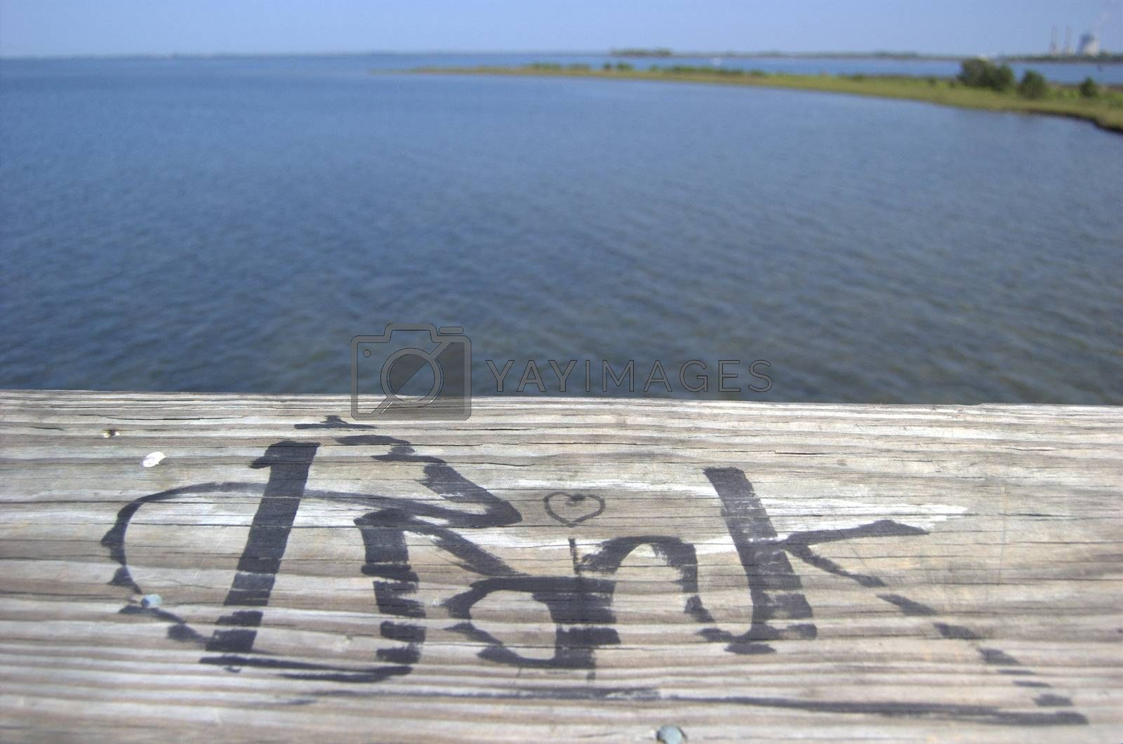 Graffiti on wood boardwalk on the ocean