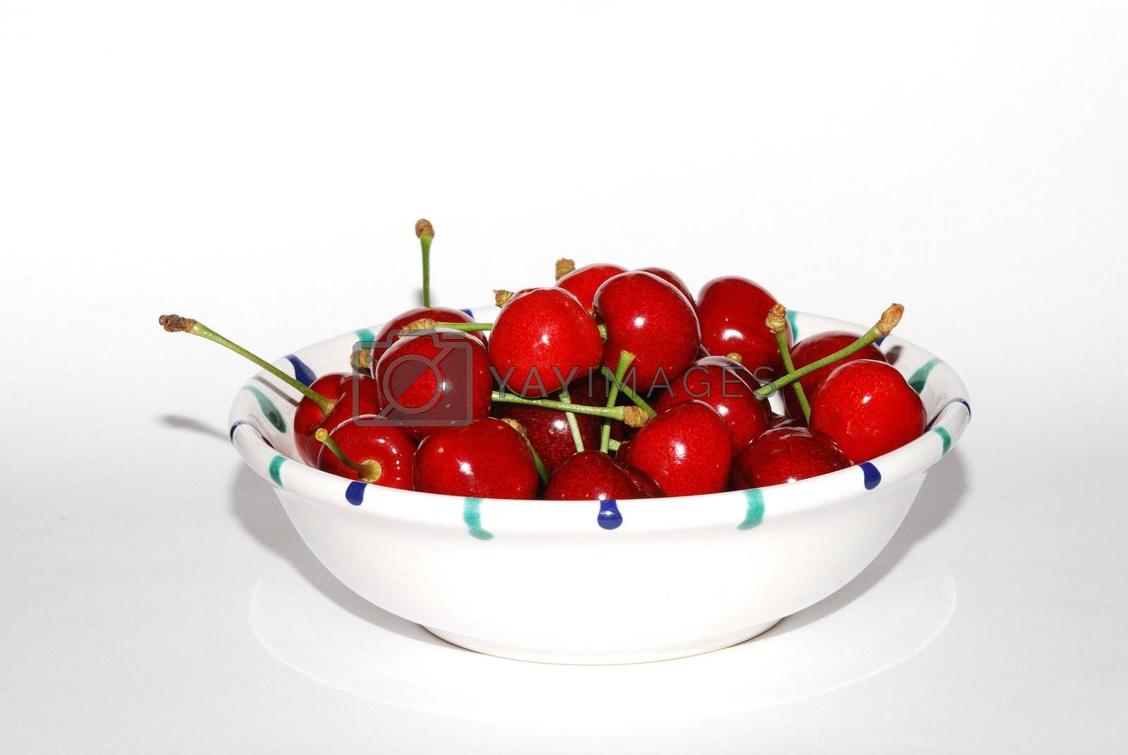 querformat many juicy red cherries in a bowl