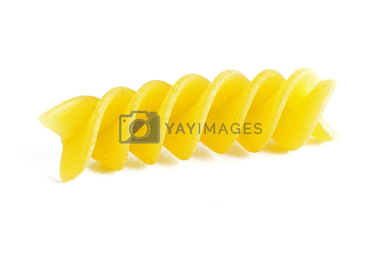 A colorful yellow raw fusilli on a white background