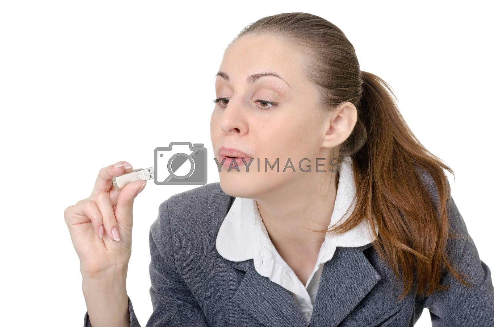 office manager, a woman closely examining USB flash drive