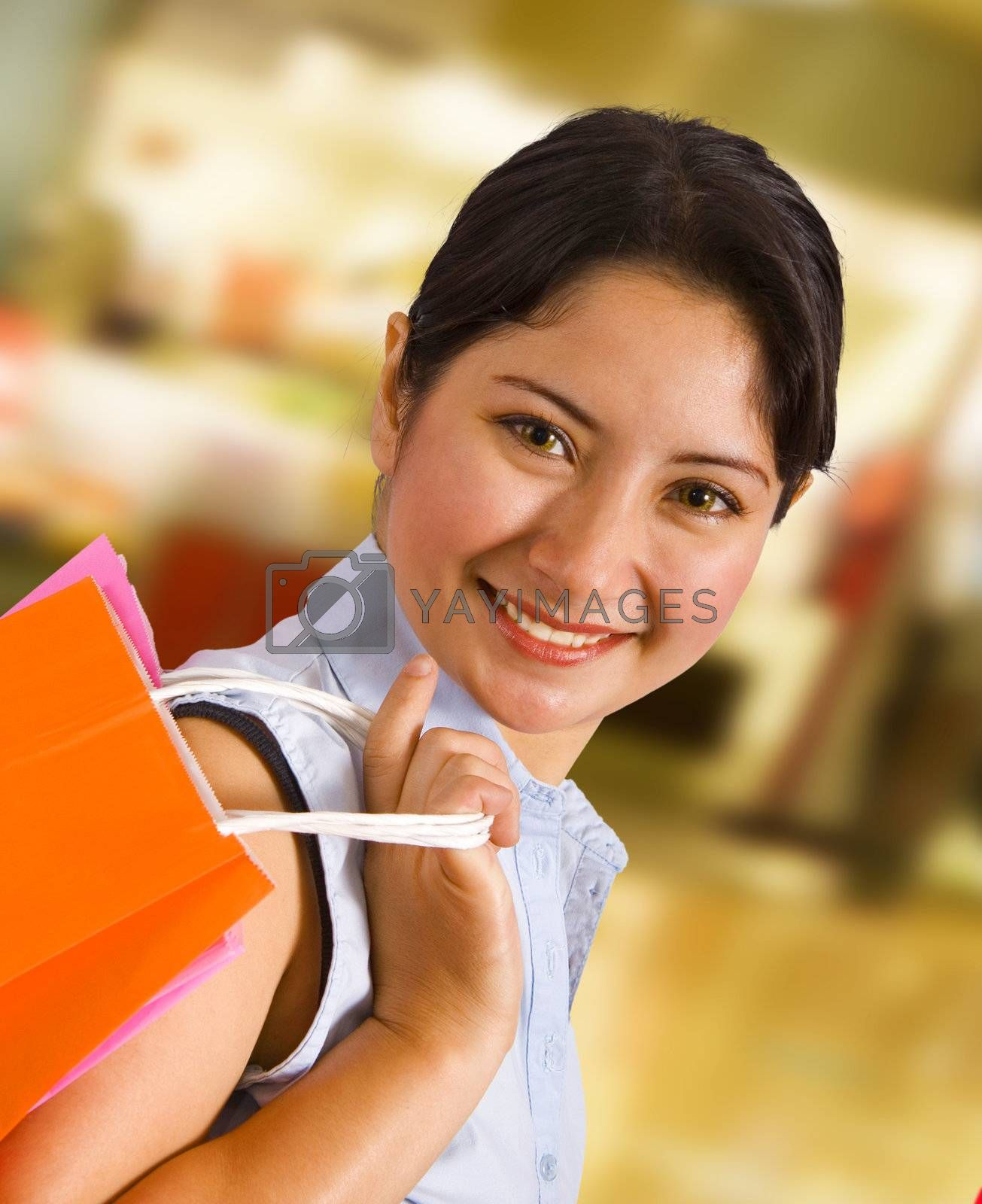 Woman In A Shopping Mall Carrying A Shopping Bag