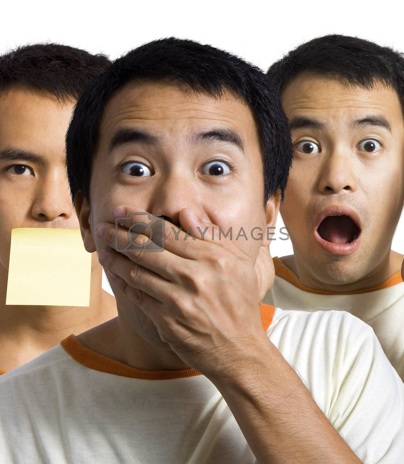 3 shocked, surprised and amazed men, one with his hand over his mouth