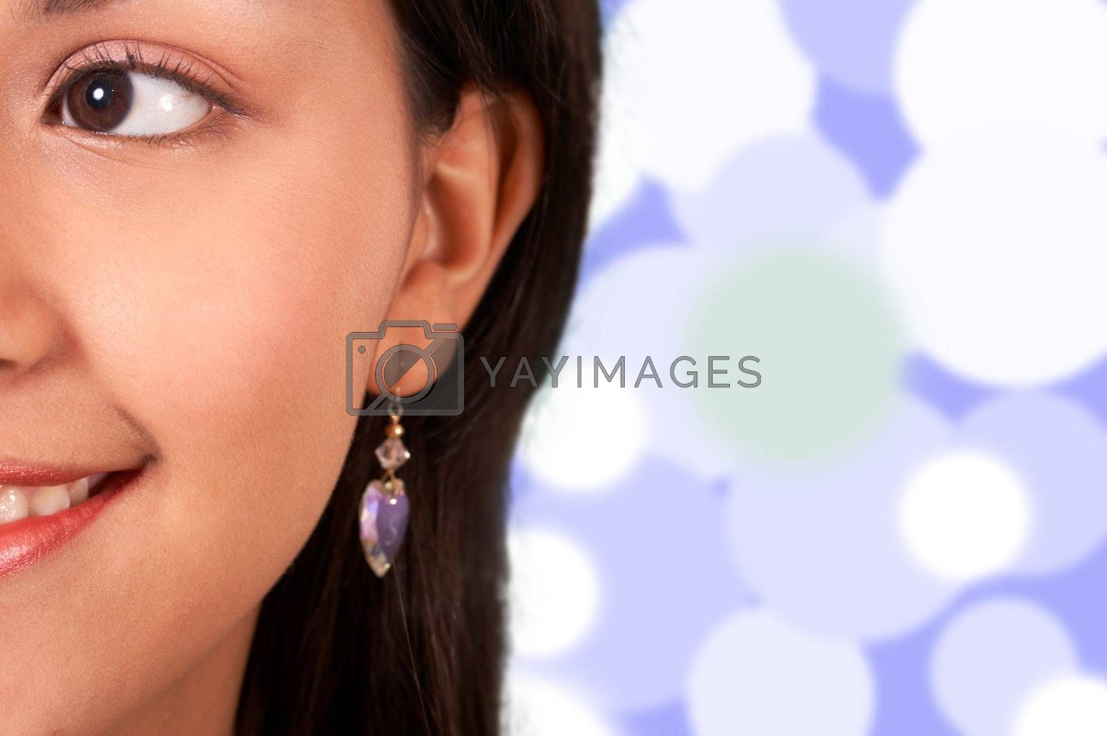 Smiling Girl With Blue And Lights Background
