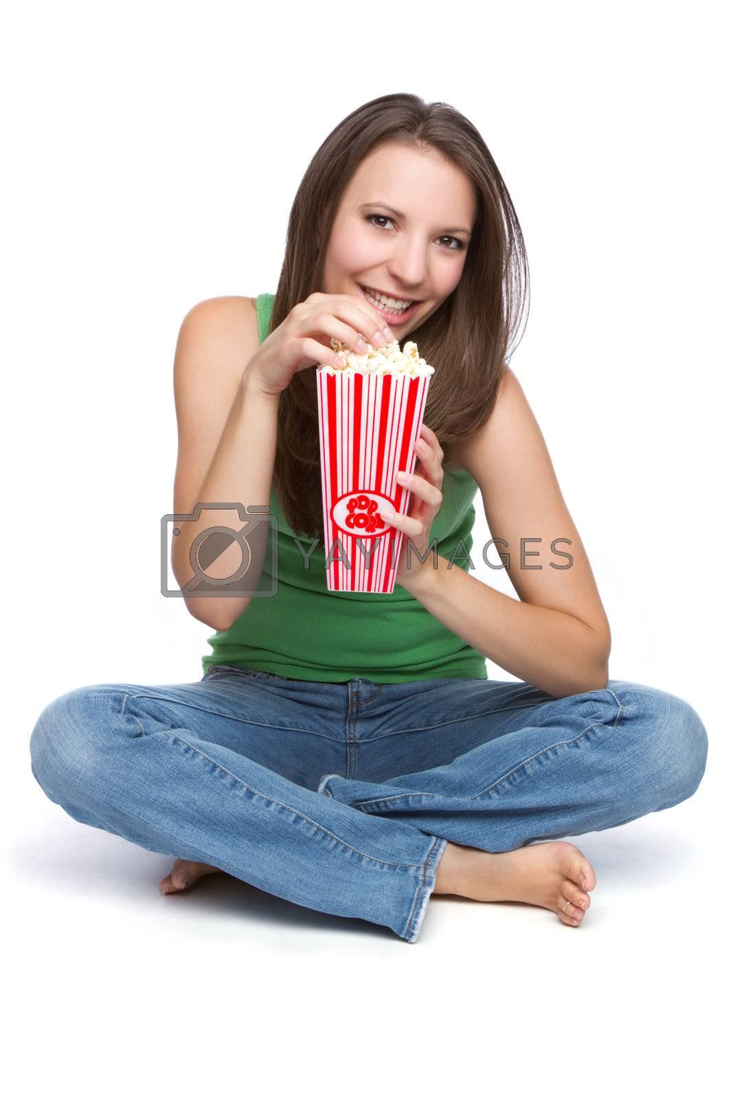 Pretty teen girl eating popcorn