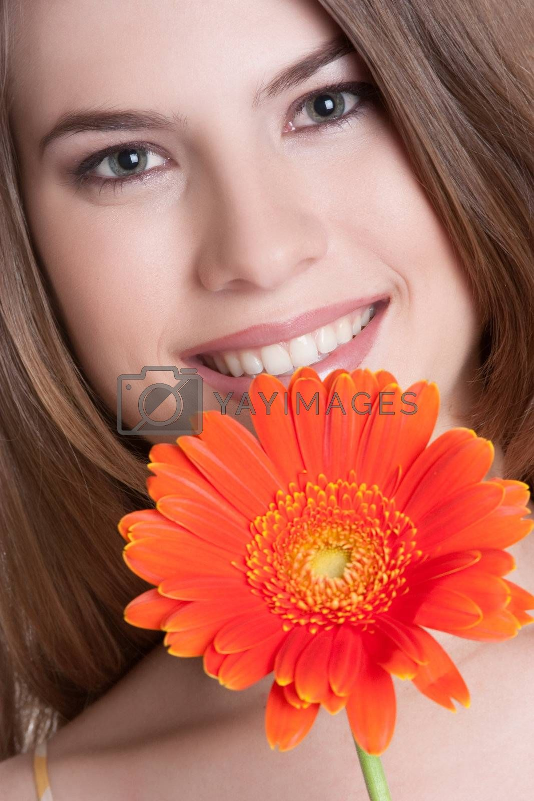 Beautiful smiling woman holding flower
