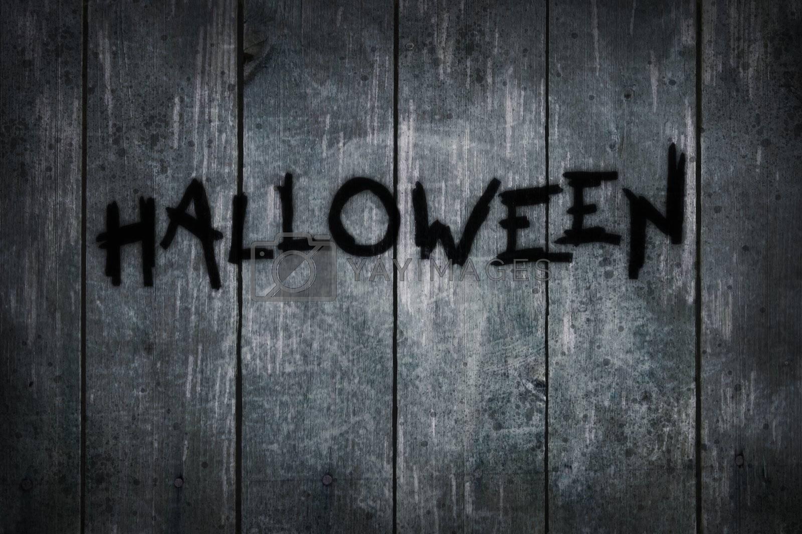 the word halloween on old wooden planks - illustration