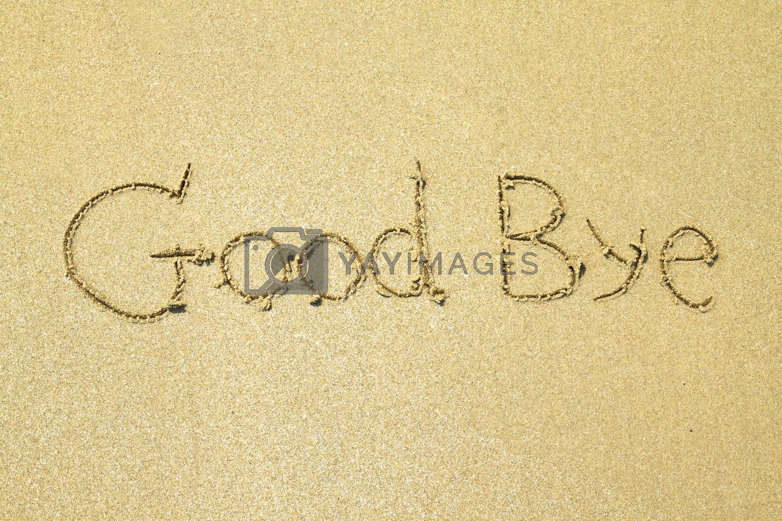Good bye written on the sand at the beach