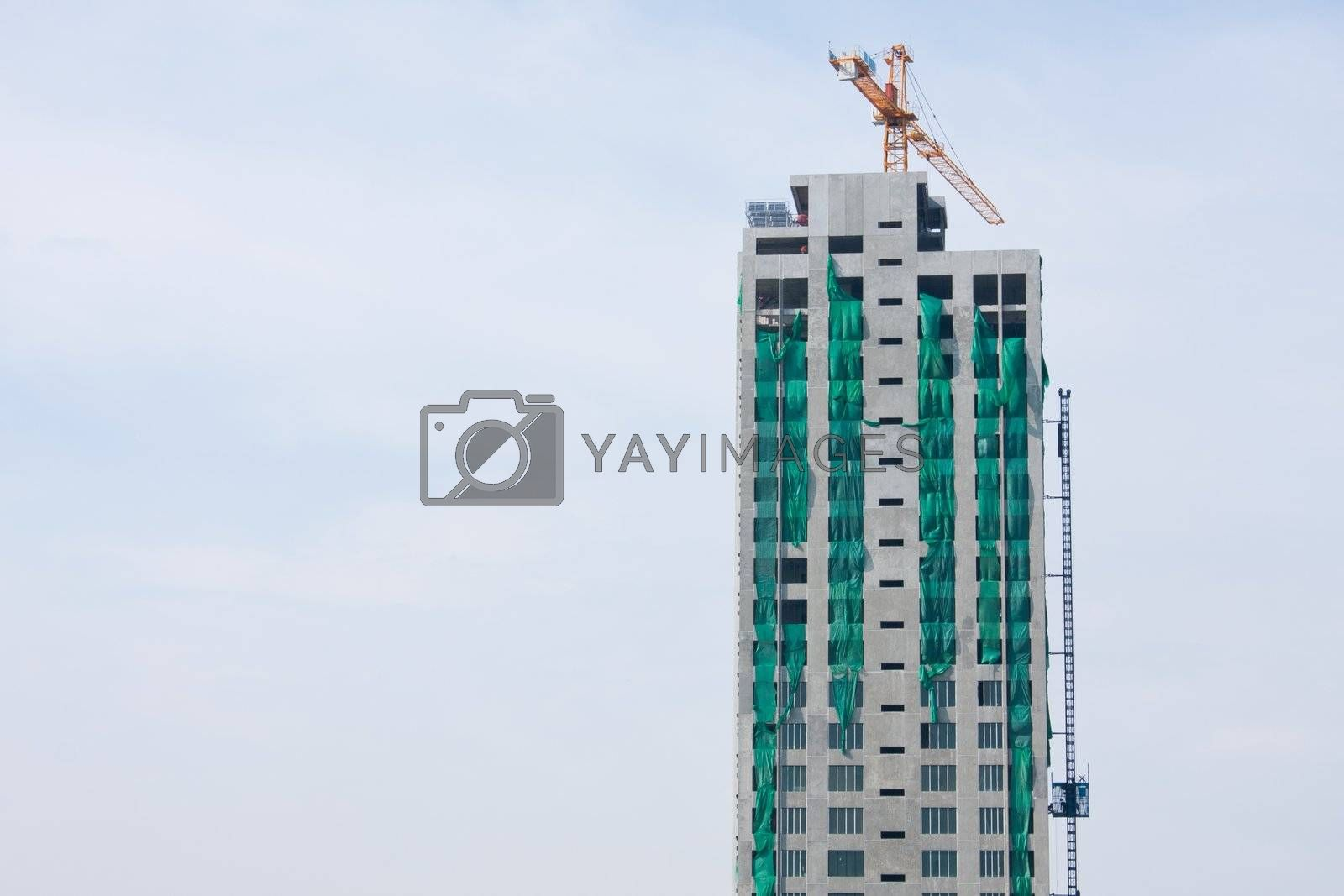 Construction of towers, tall buildings are working.