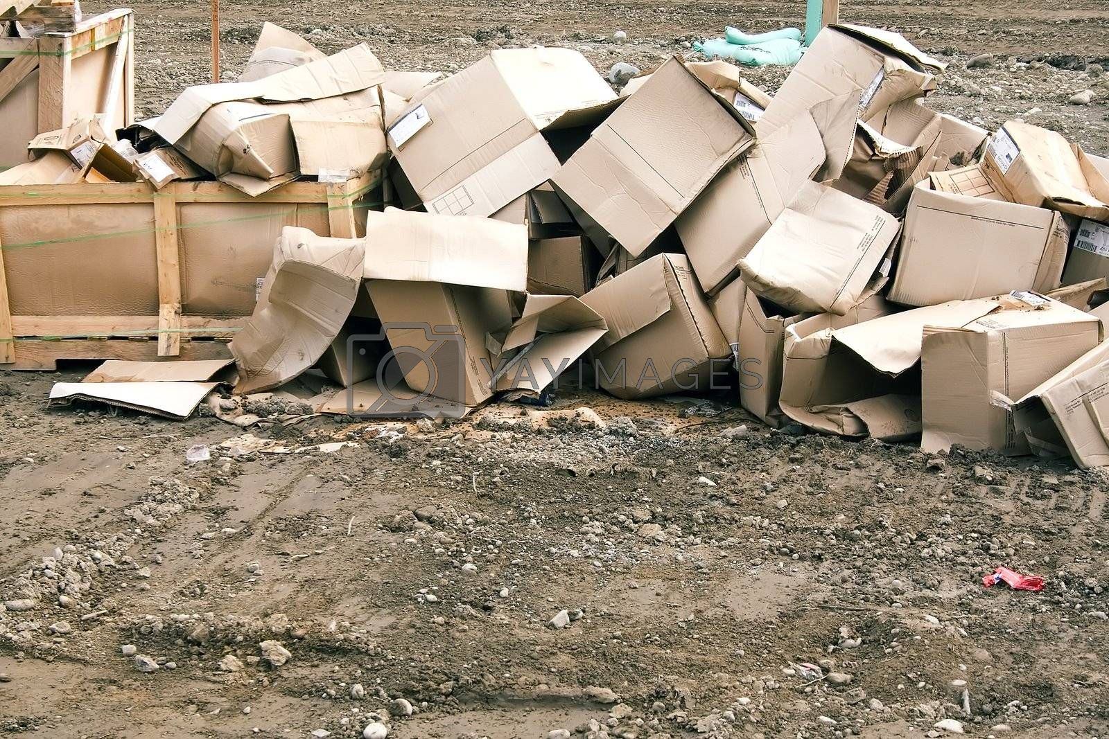 Empty cardboard boxes ready for recycling at a construction site.