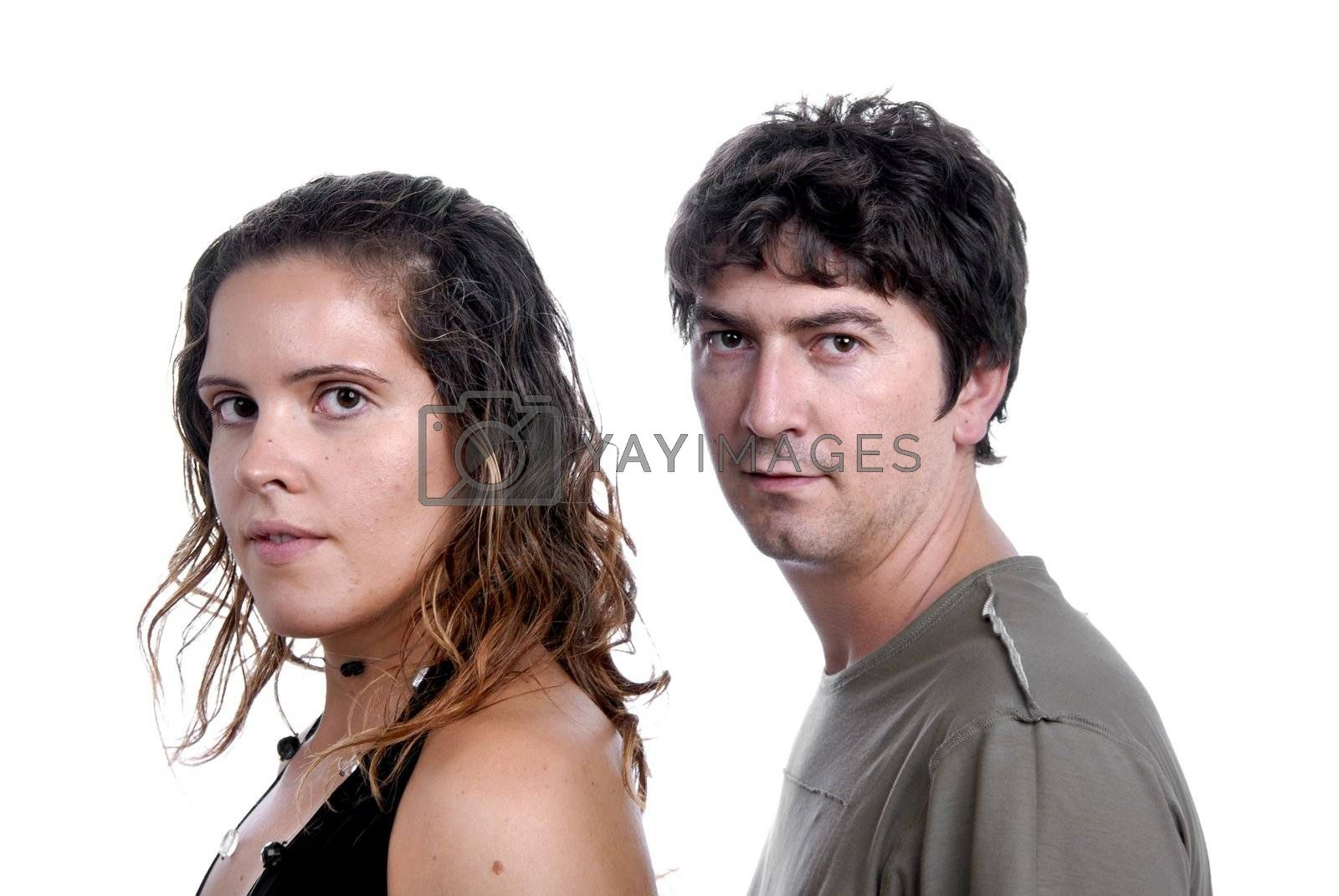 young casual couple portrait in studio shot
