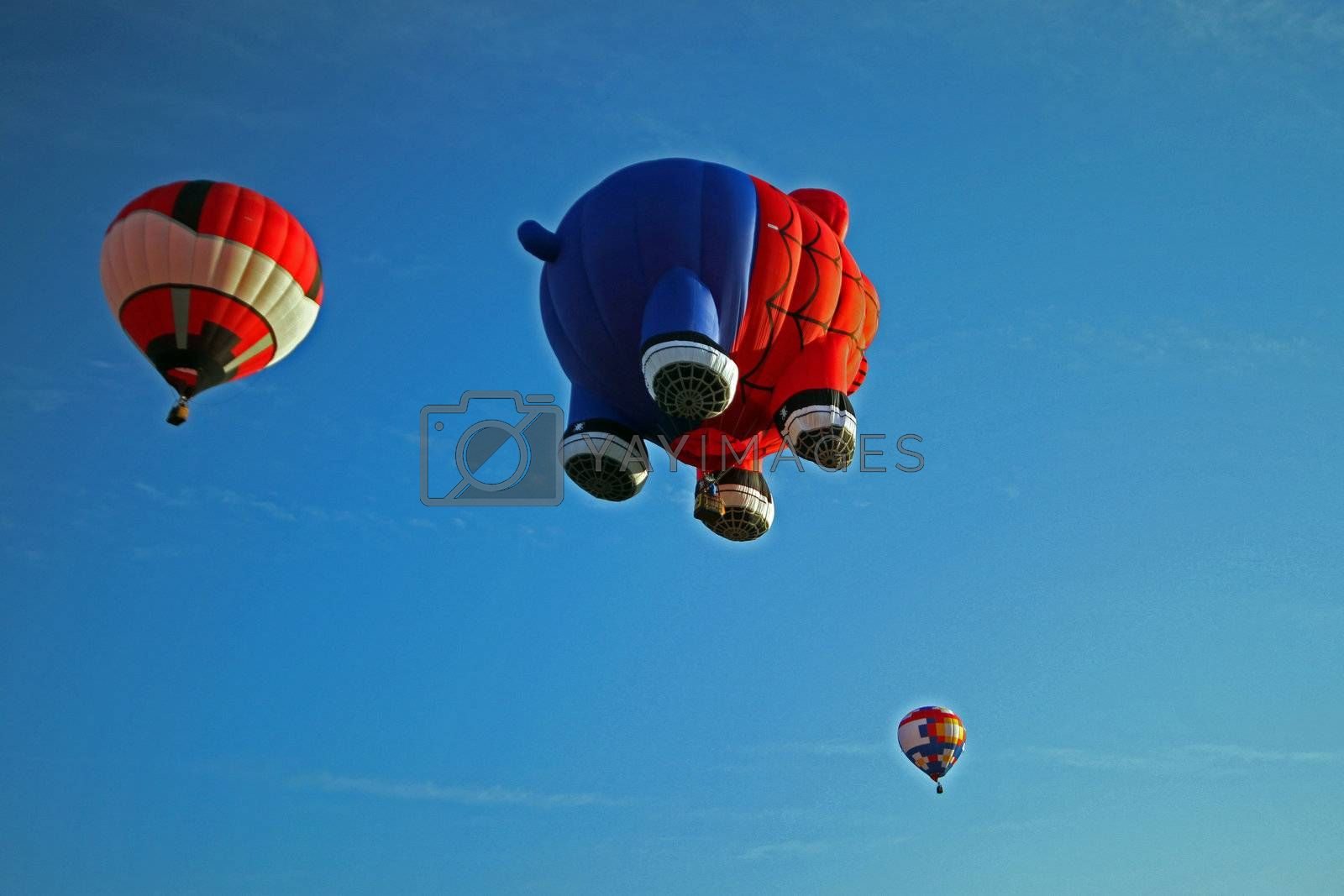 Hot air balloon shaped as a pig dressed in a spiderman suit