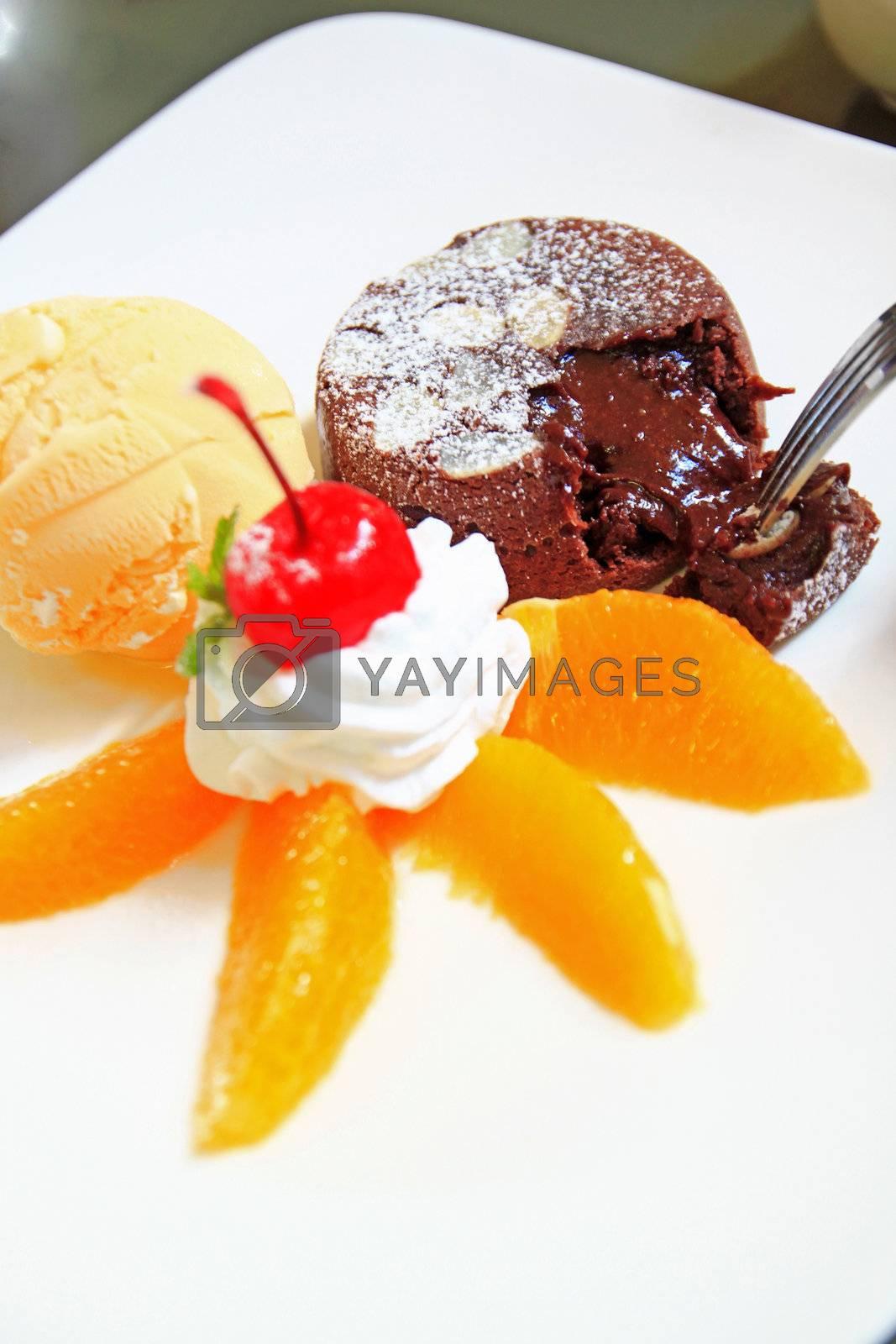 hot chocolate cake with ice cream and orange