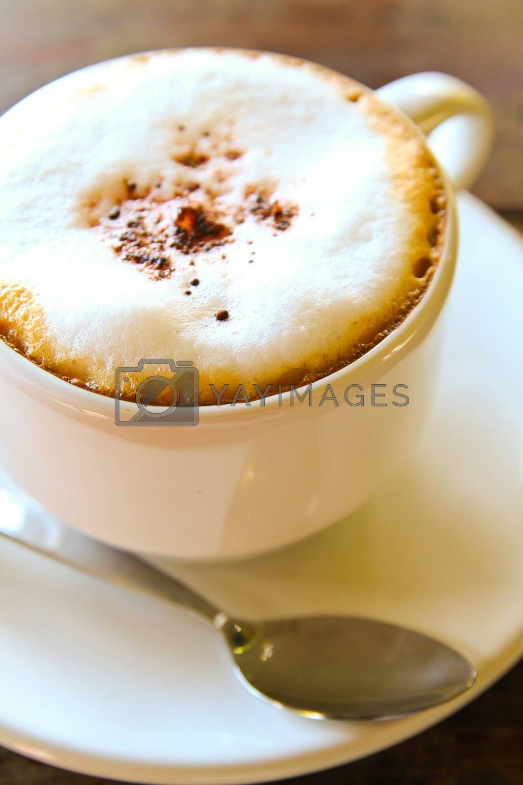 Cappuccino cup with metal spoon