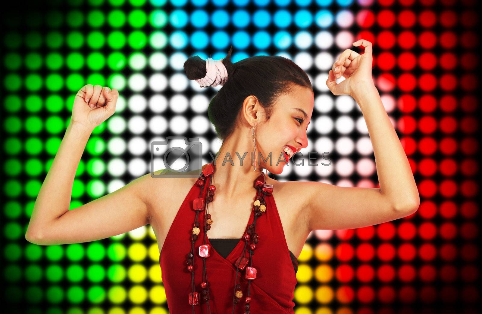 Beautiful Young Woman Dancing At A Club With Multicolored Spotlights Background