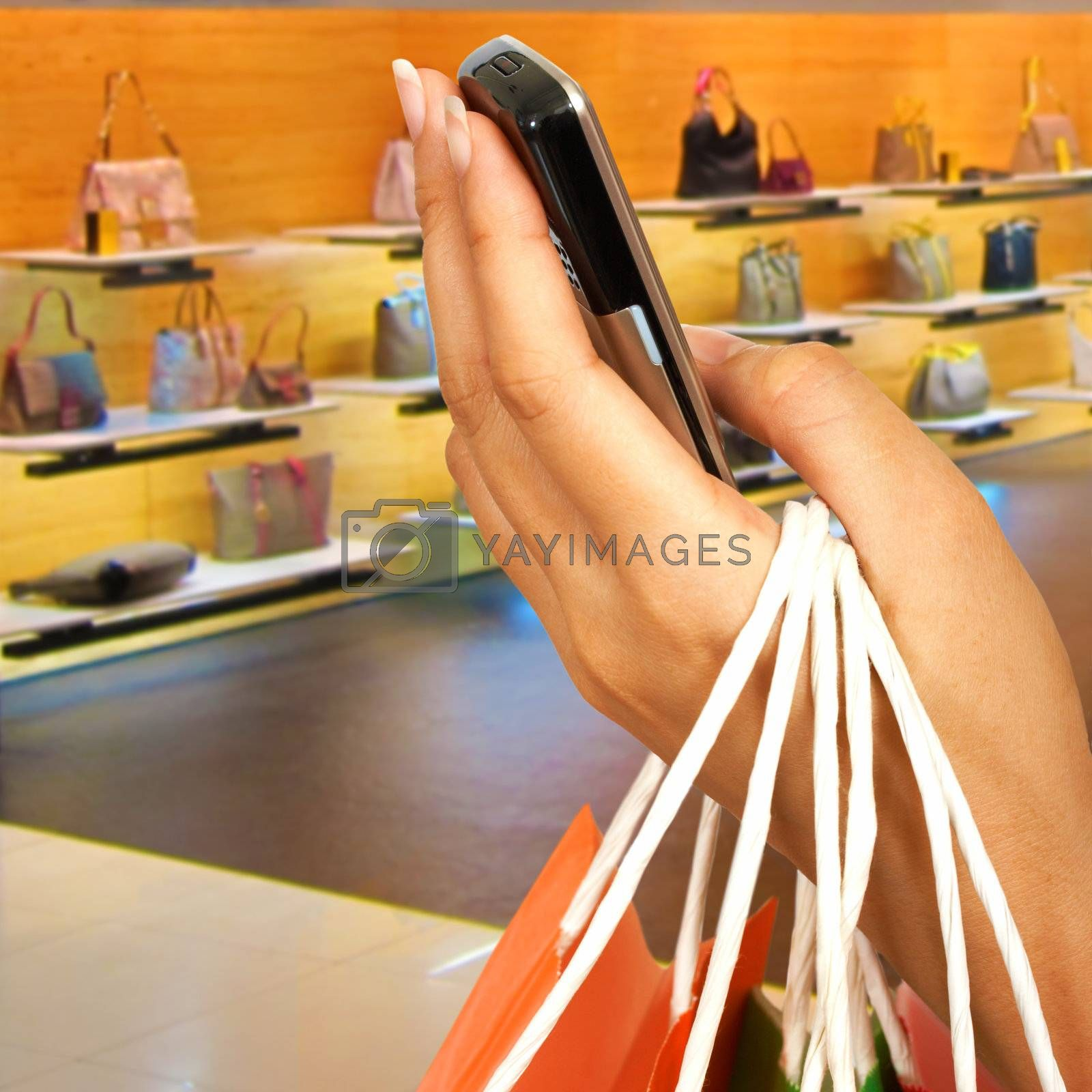 Making A Phone Call In A Shopping Center Outside A Handbag Store