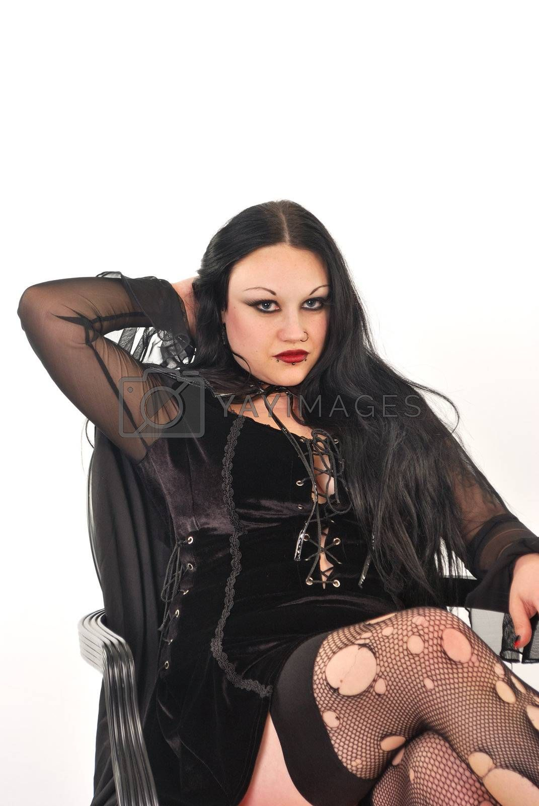 Gothic girl sitting in stockings