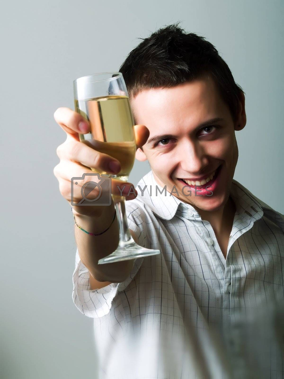 Young man drinking champaign