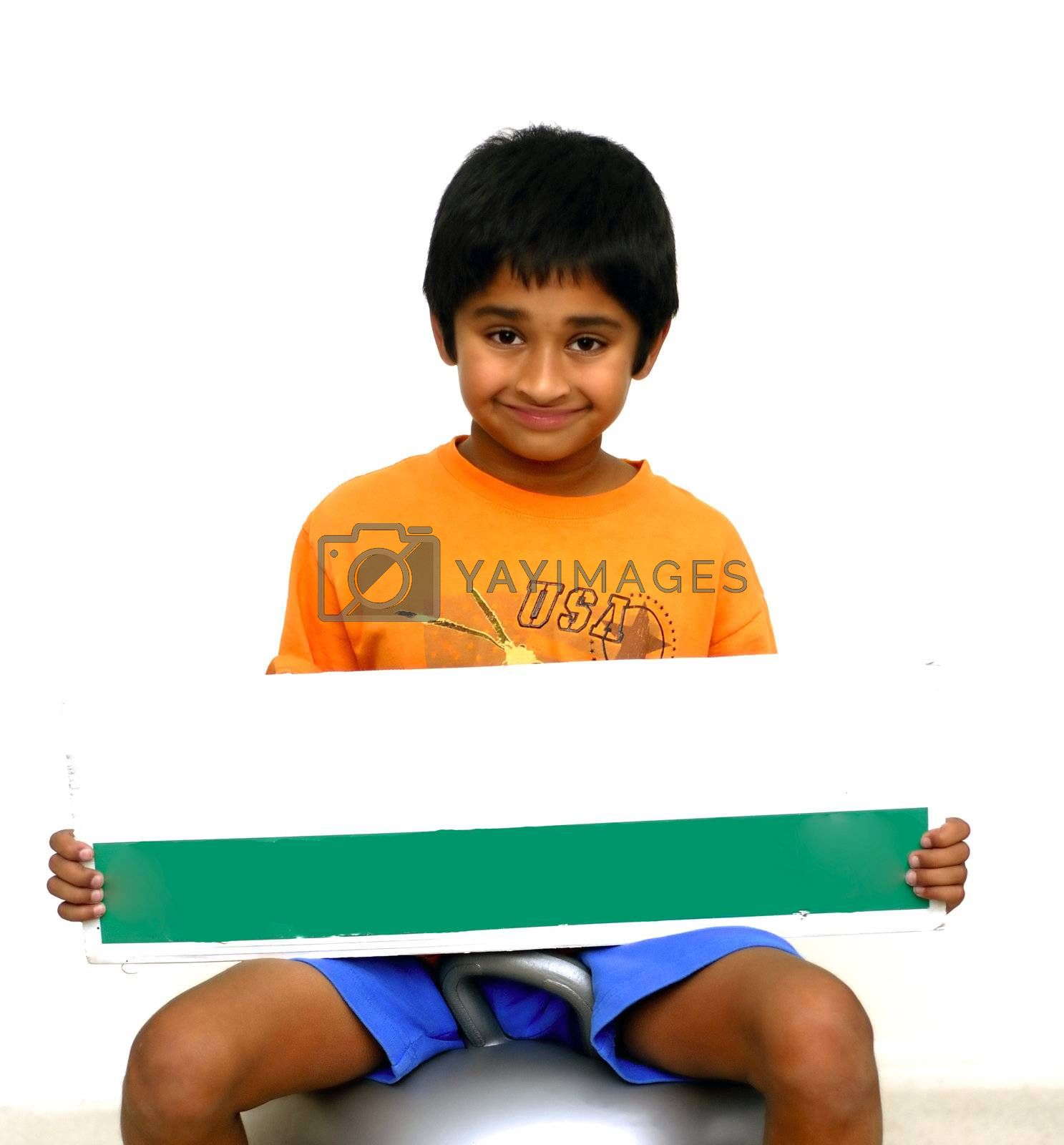 An handsome Indian kid holding a sign board