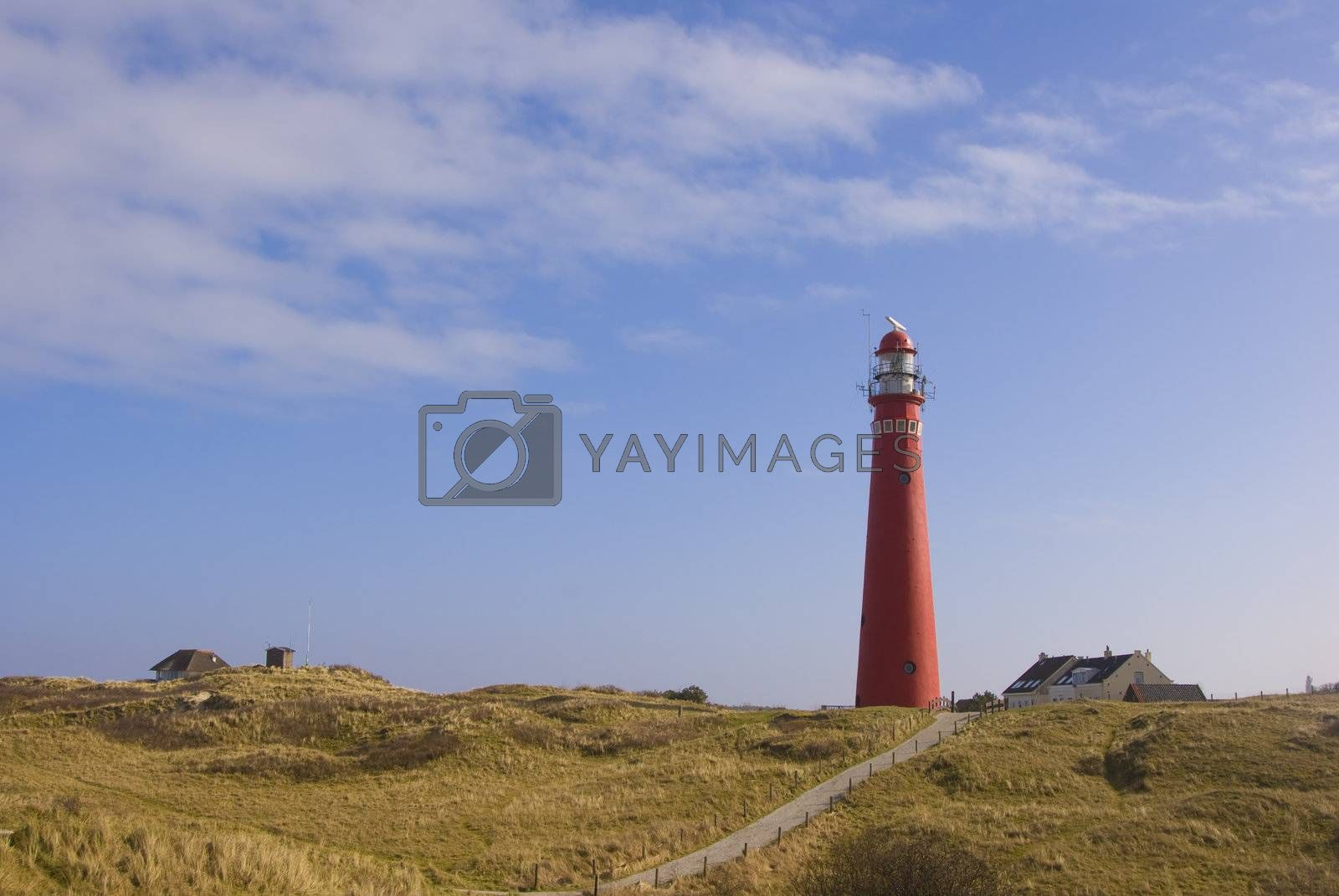 Red Lighthouse in Dunes at Schiermonnikoog by huijzer