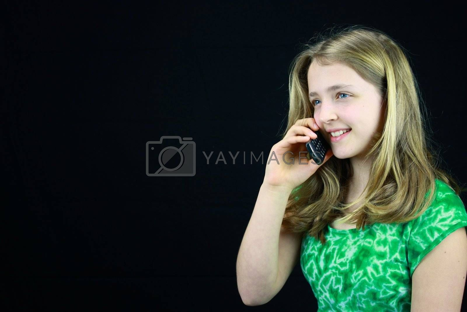 Young Blond haired girl using a cell phone