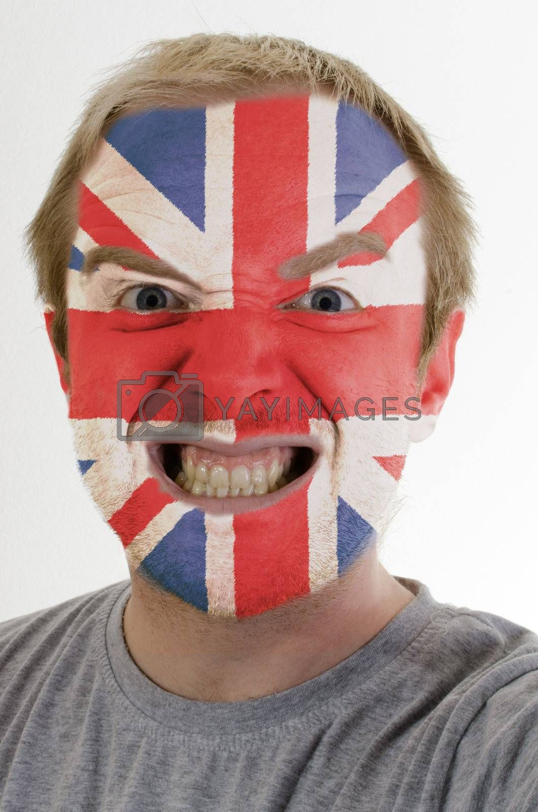 High key portrait of an angry man whose face is painted in colors of united kingdom flag