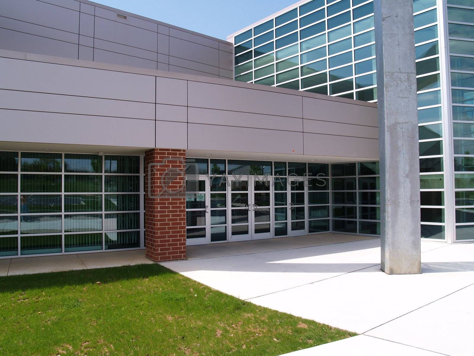 front of a modern brick and glass building