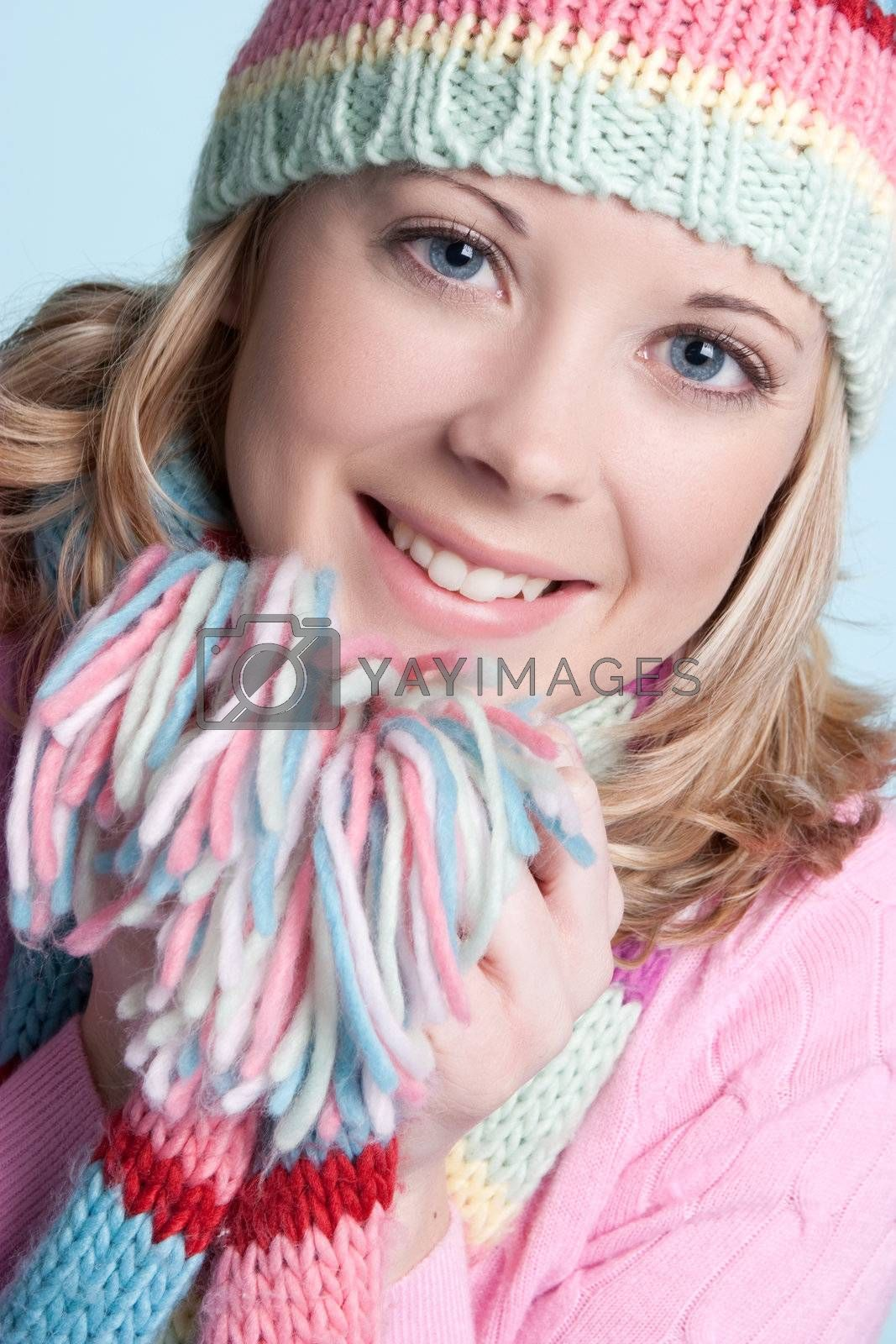 Beautiful smiling blond winter girl