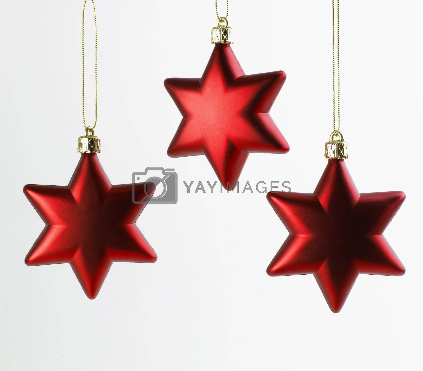 Royalty free image of Three Christmas Stars by studiovitra